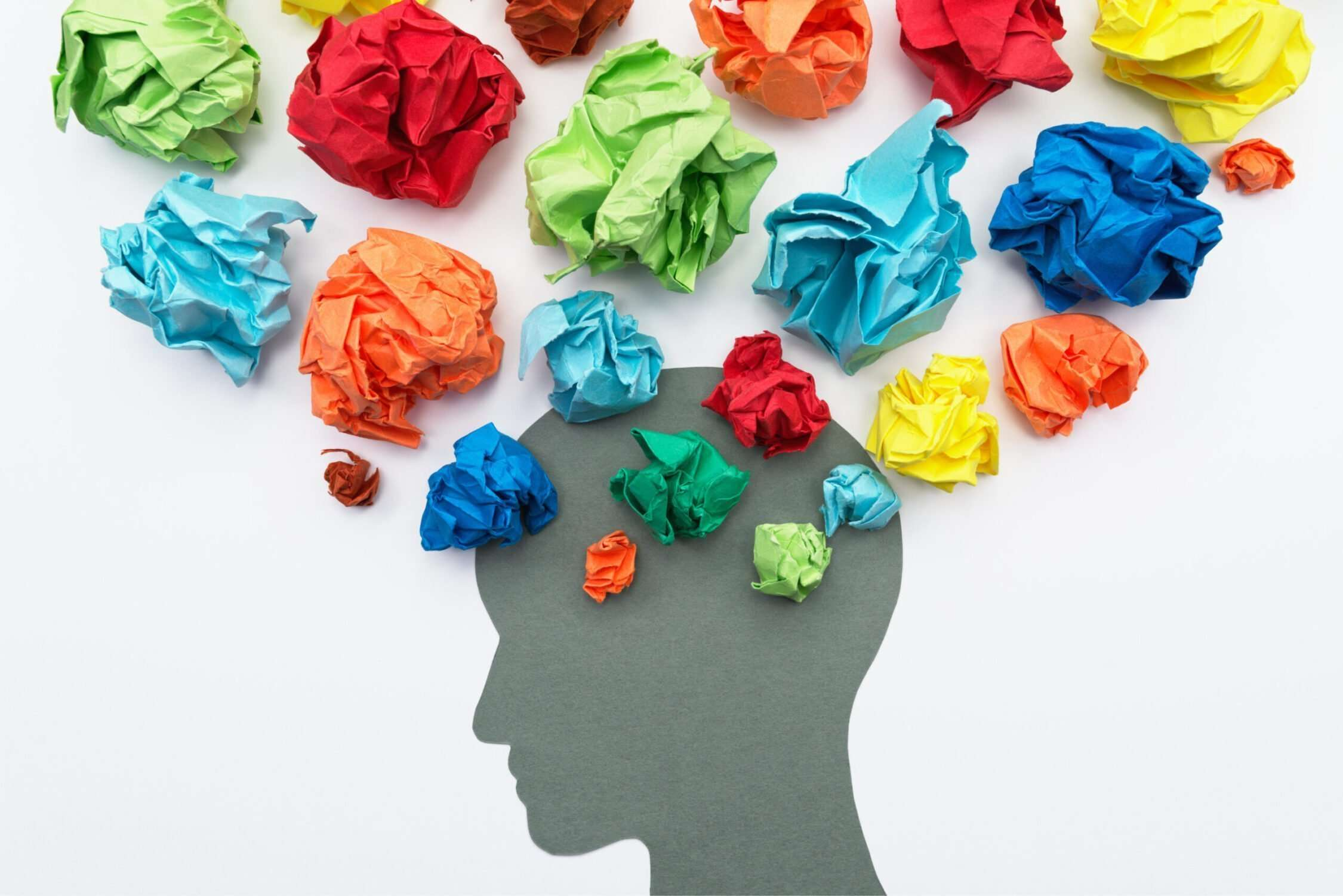 Mental health - head with coloured crumpled paper