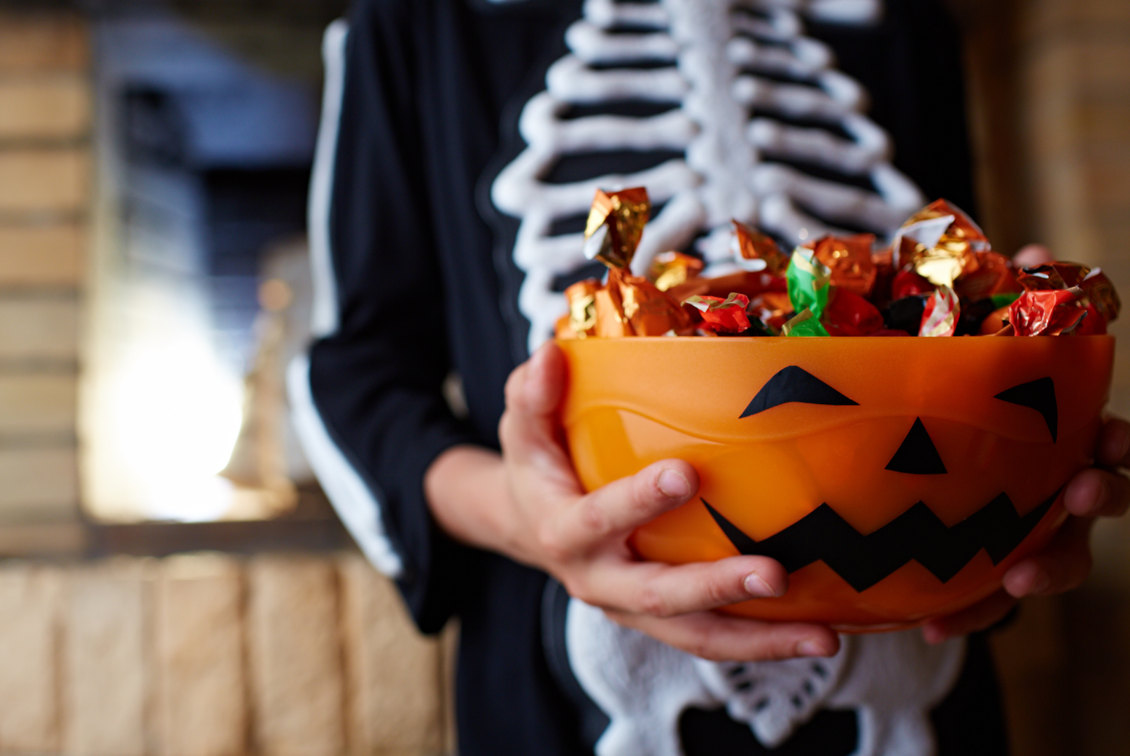 Halloween candy with kid dressed as skeleton